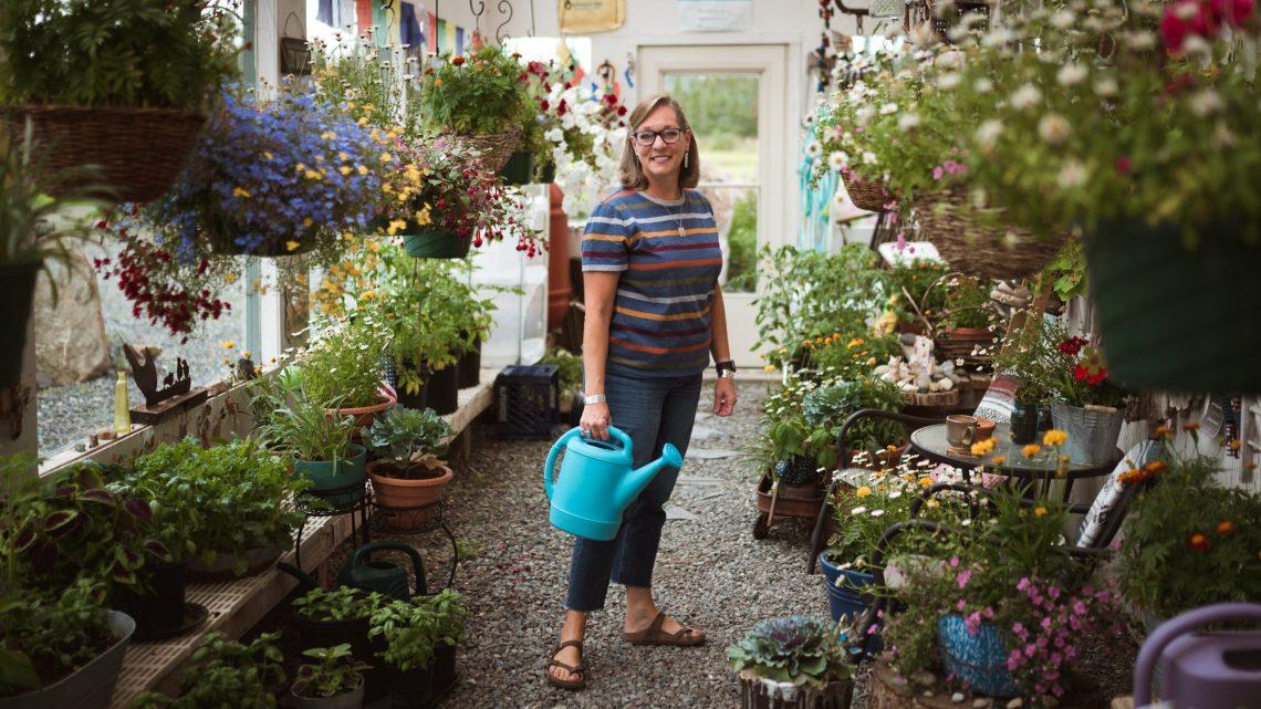 Tammy Van Wyhe stands among her plants